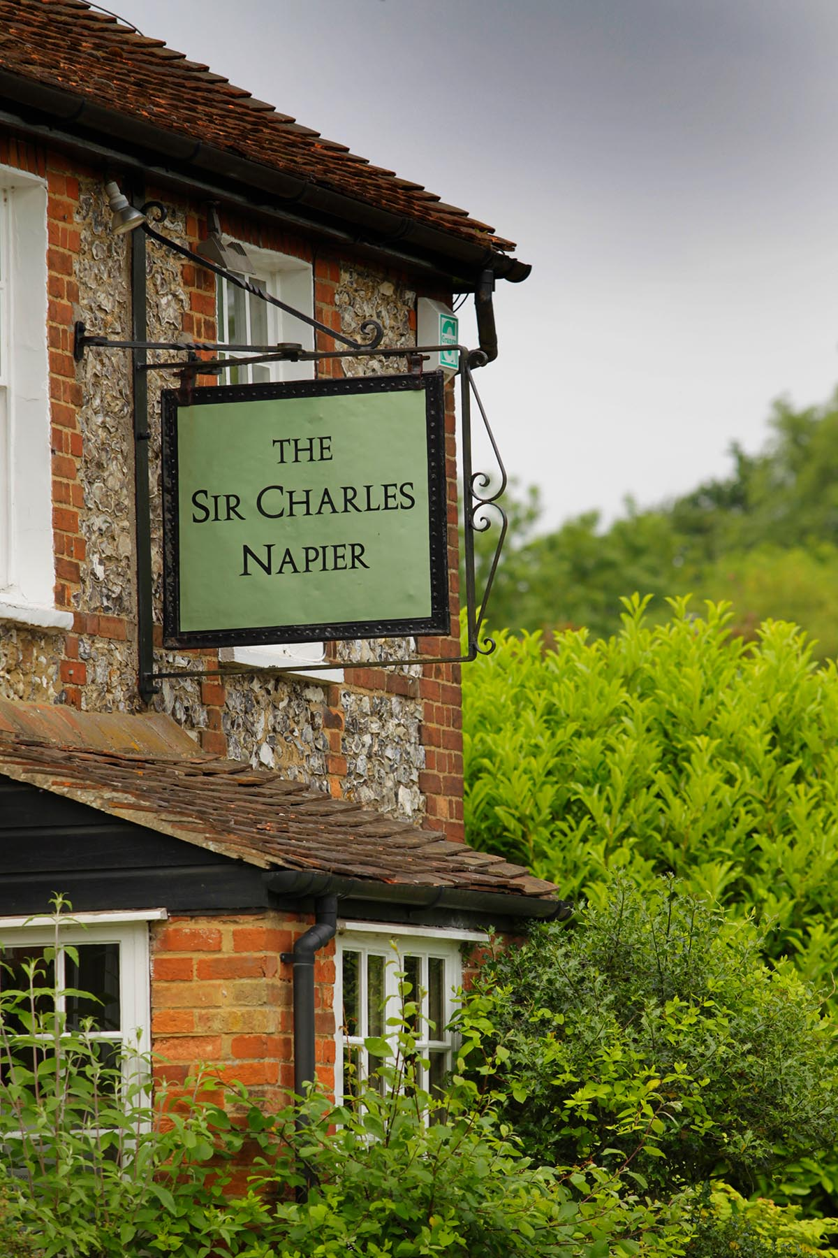 Exterior of The Sir Charles Napier with close up of sign